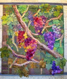 lovely grapevine quilt on exhibit in jerusalem, on debbie's fiberwork blog