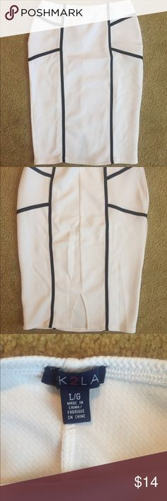 B&W pencil skirt White skirt with black line design. Thin material suggested to wear with slip or stockings. Small slit in back. Cute for summer ! Dress up with heels and blouse or down with tank and sandals. Never been worn. Can also fit a medium Skirts Pencil