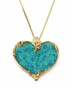 Soulful Gold Heart Necklace - Turquoise Color Adina Plastelina Handmade Jewelry. $134.99. Arrives in a joyful yet elegant gift box. Bounteous heart pendant inlaid into a joyful pattern, soulfully suspending from a chain. Click on Adina Plastelina Handmade Jewelry above the product title to view the entire alluring collection on offer. A 19.7 inches, 50cm, chain is included. Please note, chain type may vary from that on the picture. Pendant measures 1x1 inches, 2.5x2.5cm. Mille...