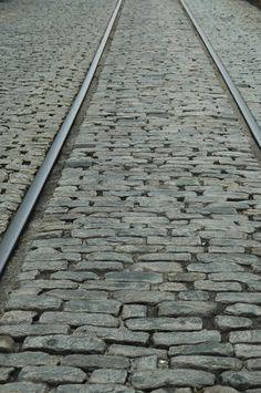 Tracks and cobblestone on River Street, Savannah.