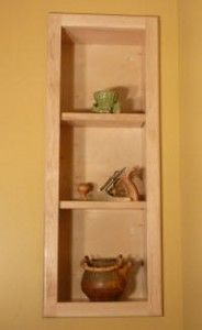 Building a recessed cabinet for in between wall studs. between-the-studs-display-shelves-0
