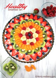 Beautiful Healthy Breakfast Tart made with a Medjool date and nuts crust, yogurt filling, plus fresh fruit. Low sugar and #glutenfree !