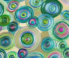 This picture represents shape. It has many different sizes of circles making a variety. There is a lot of positive space filled by the flat circles.