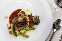Devonshire Ruby Red Beef fillet with shallot and horseradish cream, celeriac puree, English asparagus, wild mushrooms, roasted shallots and red wine sauce | FOUR Magazine