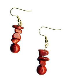 """Red Coral Earrings - Ancient Egyptians, Phoenicians and Romans all used coral as a method of currency and trade. Some ancient societies believed that ships needed to have coral on board as a defense against lightning. Coral has even been found on artifacts dating back to 3,000 B.C.    Earwires are gold plated surgical steel. Earrings are 2"""" long, 1/3"""" wide. Coral is dyed.  by SplendidStones on Etsy, $14.00"""