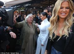 Tickled: Meanwhile, younger sister Khloe stood by, laughing in gentle amusement as the interaction played out