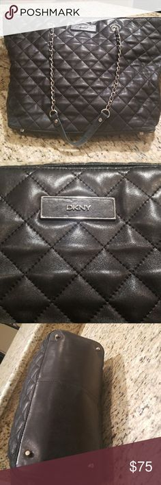 DKNY quilted leather bag DKNY soft , supple, genuine leather bag.  Measures  17 inches by 11 1/2.  Chain and leather handles.  FLAWLESS  interior that is so dark  it didn't photograph well.  One zippered inside pocket & 2 interior open side pockets as well.  There is slight wear on the 4th picture, bottom of the bag.  Otherwise a very soft supple versital find. Dkny Bags
