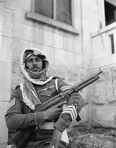 An Arab legion soldier fingers a machine gun as he stands guard in Jerusalem on Jan. 6, 1948 where his army is on loan to the British army to help out because of shortage of British soldiers in the holy land. (AP Photo/JP) Ref #: PA.7445783 Date: 06/04/1948