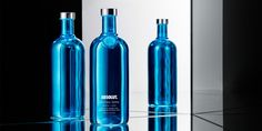 """This holiday season Absolut Vodka has taken a departure from their  well-known """"highly decorative"""" art direction and have released minimalist,  single color blue and silver bottles that sparkle like Christmas tree  lights. Absolut Electrik is a global limited edition Absolut Vodka bottle  that is covered in a semi-transparent metallic, mirror-like coating that  will be grabbing attention wherever it goes."""