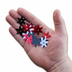 "Any party is better with confetti, so pick up some of this ninja warrior confetti to accent a martial arts or ninja themed party. The confetti is shaped like ninja shurikens and comes in black, white, and red colors. They have a metallic gleam to them and measure approx. 1 inch in diameter. Each packet contains 2 ounces of confetti (about a coffee cup full) so be sure to get enough to celebrate with a bang! Product highlights: Hundreds of 1"" pieces Metallic finish Unique ninja star ..."