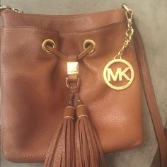 Brown Michael Kors satchel Only have owned it for five months! Practically brand new and in really good condition. Has a big pocket with two little pockets inside, and a pocket on the front. Perfect little satchel for an easy to grab purse! Michael Kors Bags Satchels