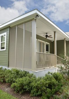 View LAS' beautiful full line of HomeGard and RollGard Shutters. Affordable, durable shutters provide storm protection and improve look of your home. Bermuda Shutters, Side Porch, Front Porch, Wall Design, House Design, Privacy Walls, Homekeeping, Outdoor Settings, Photo Galleries
