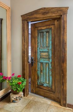 A classic antique Mexican door in surround serves as an office entry here at La Puerta Originals. The door's original finish and details were preserved. Cool Doors, The Doors, Entrance Doors, Windows And Doors, Front Doors, Vintage Doors, Antique Doors, Rustic Doors, Old Wooden Doors