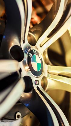 BMW wheel rim iPhone wallpaper, More sports car pics images at www.freecomputerdesktopwallpaper.com/wcarsten.shtml