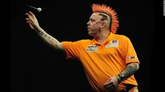 Colorful darts player Peter Wright competes against Michael van Gerwen during a Premier League Darts match Thursday, March 5, in Exeter, England.