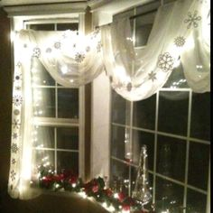 Snowflake garland on my front window