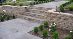 Retaining Walls - Dry Stack retaining walls are a structure that is built without mortar and is usually built against a slight hill. Dry stack retaining walls can naturally drain moisture from the soil.