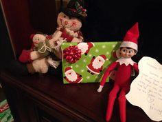 Elf on the shelf - elf brought a present to the kids; a Christmas movie