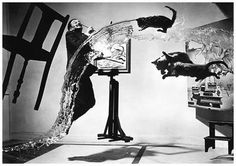 Philippe Halsman, who made a career out of photographing people jumping. An example.