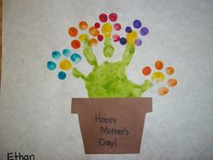 "We painted their hands green to resemble a flower and then used their finger to dot petals onto each stem.  Mrs. Ma and I added a little brown pot that said ""Happy Mother's Day!"" and it was complete."
