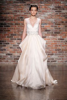 STRAPS! SEMI-SLEEVED! Jim Hjelm peachy-pink gown at bridal market for fall 2014 | via junebugweddings.com
