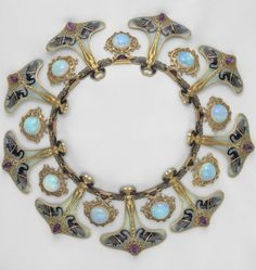 fashioninhistory:  Necklace René Jules Lalique 1897 René-Jules Lalique was born in the Marne region of France. As a young student he showed great artistic promise and his mother guided him toward jewelry making. From 1876 to 1878 he apprenticed with Louis Aucoc, a noted Parisian jeweler. By the 1890s he had opened his own workshop in Paris and become one of the most admired jewelers of the day. Lalique avoided using precious stones and the conservatively classical settings favored by other…