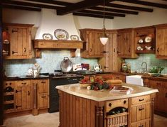 small country kitchen decorations. i like the color wood for the cabinets