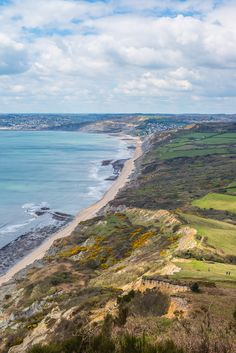 The sheer variety of rock formations, flora and fauna are demonstrated with this view from the top of Golden Cap. Golden Cap is the highest point on the south coast of England. Dorset Coast, Lyme Regis, Jurassic Coast, Great Britain, Fossil, Places Ive Been, Paths, United Kingdom, Nostalgia