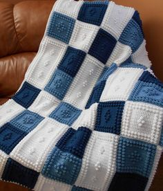 "NEW for 2014 this crocheted blanket is an original design that is easy to complete. The entire blanket requires only three crochet stitches - chain stitch, single crochet and the popcorn stitch. The pattern includes the instructions, a list of materials and the yarn amounts needed for a finished blanket approximately 47"" x 61"". The pattern can be customized to your own color choices. Also, rows can be added or taken away to create the size you would like."