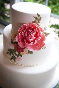 A classic wedding cake with a fondant pink flower! Yummy! {Two One Photography}