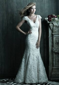 I love the vintage feel of lace wedding gowns.