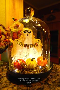 Masked Halloween Ghost in a glass cloche.