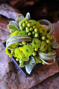 Green button mums/green berries/manipulated grass arrangement. via Stems
