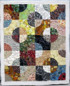 mosaic quilts in a series based on traditional and non-traditional fabric quilts