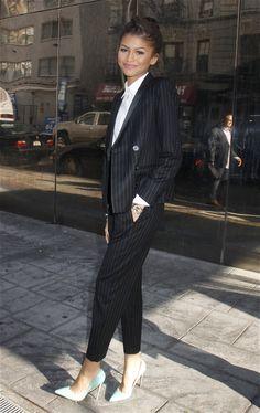 Zendaya Coleman in a Sandro pinstripe tuxedo jacket with a matching pair of wool trousers and Louboutin pumps. Zendaya Outfits, Zendaya Style, Zendaya Coleman, Outfit Posts, Fashion Pictures, Fashion Outfits, Womens Fashion, Fashion Trends, Suits For Women