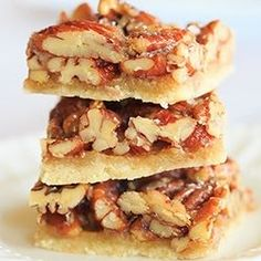Pecan bars with a shortbread-style crust and absolutely loaded with nuts!