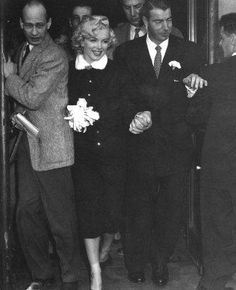 Marilyn Monroe and Joe MeMaggio, 1954.  The marriage lasted 9 months.