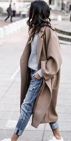 street style. camel coat. denim. sneakers.