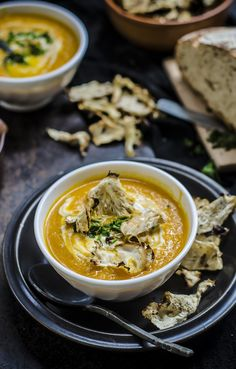 Cream of carrot, turmeric and orange soup with celeriac chips
