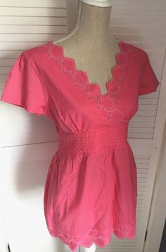 Fab fuchsia pink broderie anglais embroidered top from Marks & Spencer. UK size 12 -length: pit to pit: Low V Cross over neckline and short sleeves. Summer Tops Uk, Cotton Shorts, Fashion Clothes, Size 12, Rompers, Clothes For Women, Lady, Pink, Fashion Design