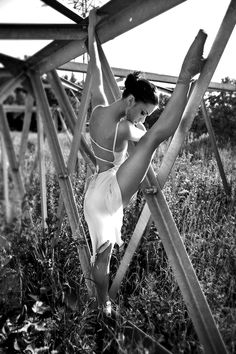beautflstranger: it all started very innocently she showing him her flexibility he marveling at her grace. but isn't it interesting that she's resting the length of her leg upon something which could resemble a st. john's cross? and isn't it further interesting that he is contemplating ripping those ties from her dress to put them to better use. ~ beautflstranger
