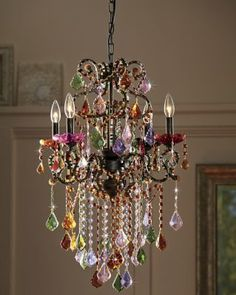 "Highlight the room with stunning color and sparkle! Exquisite in every detail, this chandelier shimmers with strands of round beads and faceted crystal gems. Ruffled cups accent each light, on 4 curved arms, with dangling crystals. All orbit an ornate coppertone frame. Uses four 40-watt max. candelabra bulbs (not included). Comes with a 40"" l power cord with domed ceiling plate and brace for hardwire mounting. Professional installation recommended. 19"" w x 29"" h x 14"" d."