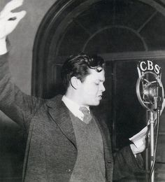 Orson Welles during a radio broadcast, 1936