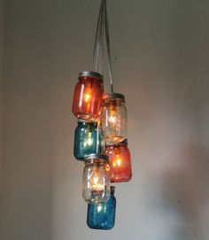 We want this clustered chandelier hanging in our homes all year! Buy it on BootsNGus.