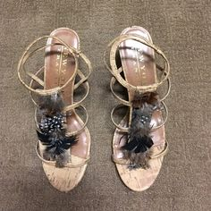 Gorgeous cork and feather heels. New York Transit cork heels with cute feathers. New York Transit Shoes Heels
