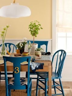 easy decorating updates for less : paint mismatched chairs the same color to unify. Love that blue too! Dining Room Chairs, Dining Furniture, Table And Chairs, Blue Chairs, Colorful Chairs, Painted Dining Chairs, Colored Dining Chairs, Furniture Ideas, White Chairs