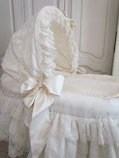 White ruffled bassinet with bow - ready for a precious baby