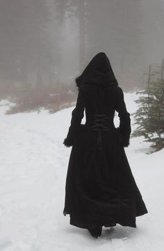 Long black hooded coat. Reminds me of little red riding hood even though this coat is not red