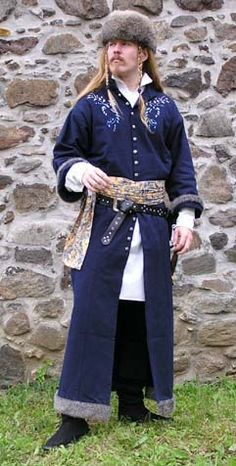 Dress of eastern Slovakia    inspired by Italian influence on this part of Slovakia, turn of late gothic and early renaissance    Dark blue cotton decorated by embroidery design originated from eastern Slovakia lined with grey fur, brocade sash, white shirt, hare fur hood    Author Ivanka.
