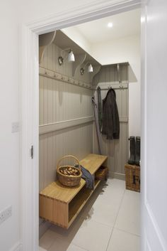 A bootroom or mudroom in the entrance to a house. Panelled wall painted in Farrow and Ball Drop Cloth and a floating shelf for shoe storage. Hallway Colours, Boot Room, Georgian Interiors, House, Home, Porch Interior, Bespoke Kitchen Design, Hallway Designs, Hallway Cupboards